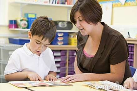 schoolboy-his-teacher-reading-class-6081096